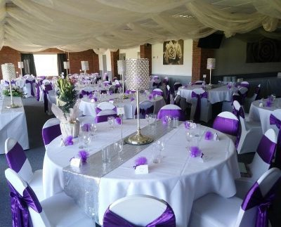 purple wedding tables at Newbury rugby club venue